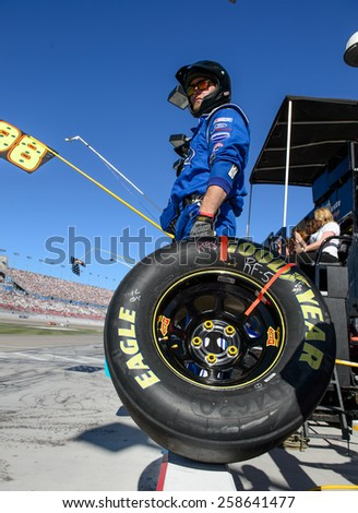 LAS VEGAS, NV - March 07: A crew memeber is waiting for Aric Almirola's car at the NASCAR Boyd Gaming 300 Xfinity race at Las Vegas Motor Speedway in Las Vegas, NV on March 07, 2015 - stock photo
