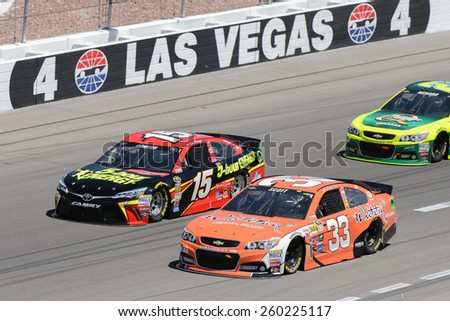 LAS VEGAS, NV - March 08: Clint Bowyer (15) passes Brian Scott (33) on th outside at the NASCAR Sprint Kobalt 400 race at Las Vegas Motor Speedway on March 08, 2015 - stock photo
