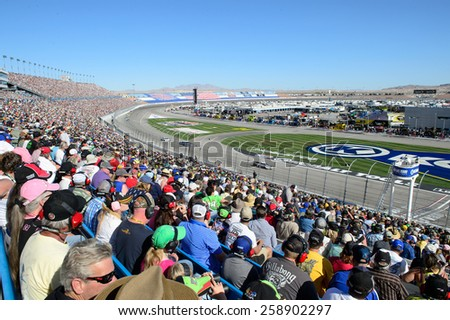 LAS VEGAS, NV - March 08: Fans in the grandstand enjoying the NASCAR Sprint Kobalt 400 race at Las Vegas Motor Speedway on March 08, 2015 - stock photo