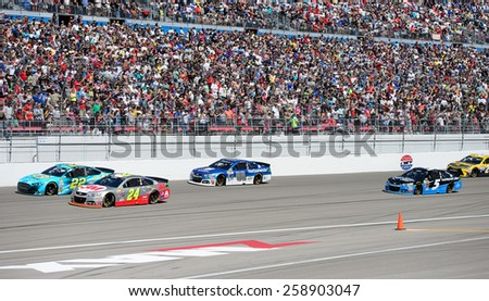 LAS VEGAS, NV - March 08: Jeff Gordon (24) and Joey Logano (22) lead the field at the NASCAR Sprint Kobalt 400 race at Las Vegas Motor Speedway on March 08, 2015 - stock photo