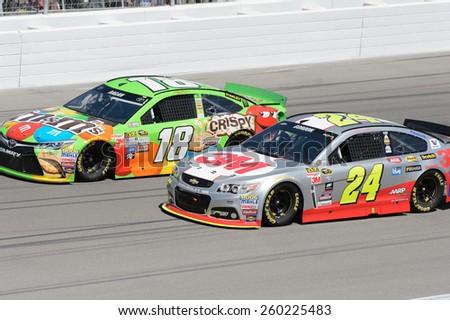 LAS VEGAS, NV - March 08: Jeff Gordon (24) passes David Ragan (18) on the inside at the NASCAR Sprint Kobalt 400 race at Las Vegas Motor Speedway on March 08, 2015 - stock photo