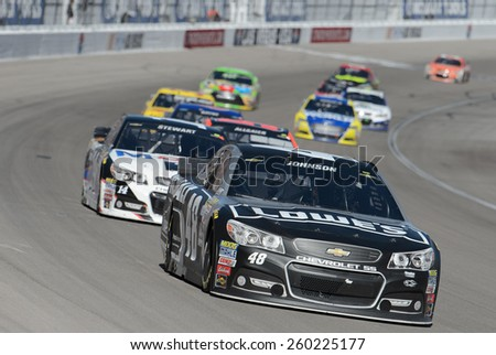 LAS VEGAS, NV - March 08: Jimmie Johnson (48) leading a pack of cars at the NASCAR Sprint Kobalt 400 race at Las Vegas Motor Speedway on March 08, 2015 - stock photo