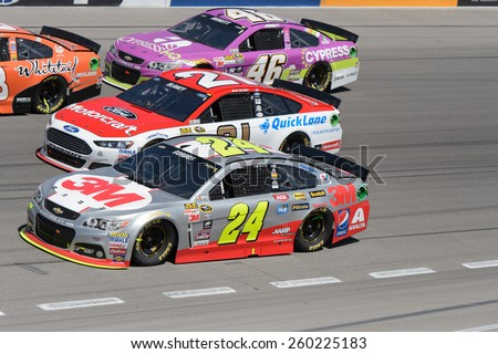 LAS VEGAS, NV - March 08: 3 wide in turn 4, Jeff Gordon 24, Ryan Blaney 21 and Michael Annett 46 at the NASCAR Sprint Kobalt 400 race at Las Vegas Motor Speedway on March 08, 2015 - stock photo