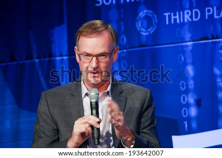 LAS VEGAS, NV -?? MAY 6, 2014: CEO EMC Information Infrastructure David Goulden makes speech at EMC World 2014 conference on May 6, 2014 in Las Vegas, NV  - stock photo