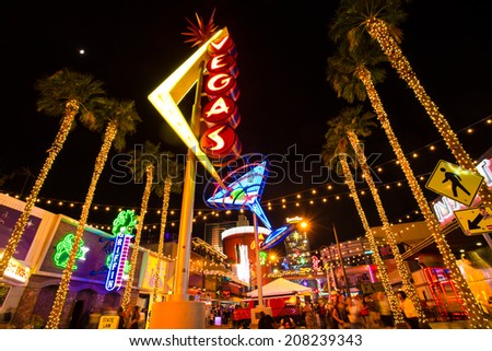 LAS VEGAS, NV - MAY 7, 2014:  View of Fremont Street with vintage lit Vegas sign in Las Vegas Nevada. - stock photo