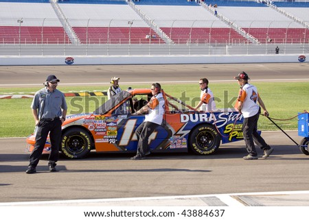 LAS VEGAS, NV - SEPTEMBER 26, 2009: Crew for Rick Crawford?s Circle Bar Ford staging the truck to qualify for the Sept 26, 2009 Las Vegas 350 truck race. - stock photo