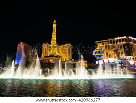 LAS VEGAS, NV/USA - MARCH 25: The Paris Las Vegas hotel and casino on March 25, 2016 in Las Vegas. The Paris hotel and a replica of the Eiffel Tower from Bellagio hotel. - stock photo