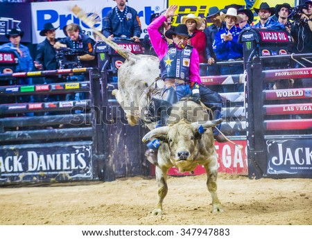 LAS VEGAS - OCT 24 : Cowboy Participating in the PBR bull riding world finals. The bull riding world championship held in Las Vegas Nevada on October 24 2015 - stock photo