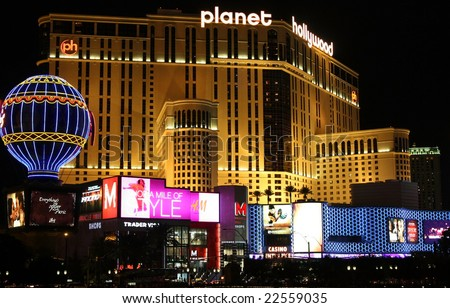 LAS VEGAS - OCT 31: Taken in Las Vegas, Nevada October 31, 2008 on the strip at night. The Planet Hollywood hotel and a shopping area. - stock photo