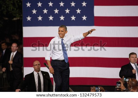 LAS VEGAS - OCTOBER 24: Barack Obama at a campaign rally at Doolittle Park on October 24, 2012 in Las Vegas, Nevada - stock photo