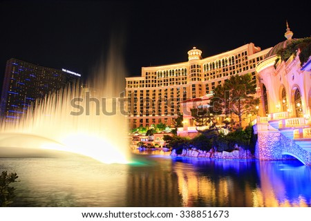 LAS VEGAS - OCTOBER 26, 2015: Famous  Bellagio resort and casino with large dancing water fountain at night.  - stock photo