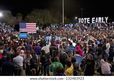 LAS VEGAS - OCTOBER 24: Supporters of Barack Obama at a campaign rally at Doolittle Park on October 24, 2012 in Las Vegas, Nevada - stock photo