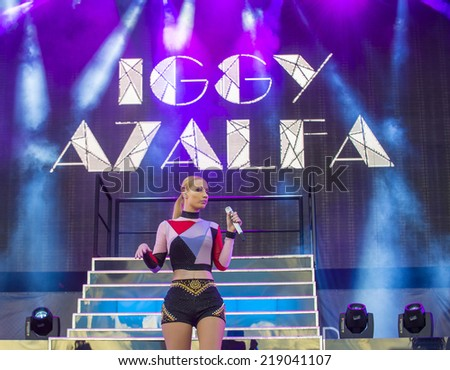 LAS VEGAS - SEP 20: Rapper Iggy Azalea performs on stage at the 2014 iHeartRadio Music Festival Village on September 20, 2014 in Las Vegas. - stock photo