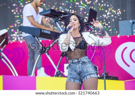 LAS VEGAS - SEP 19 : Recording artist Demi Lovato performs onstage at the 2015 iHeartRadio Music Festival at the Las Vegas Village on September 19, 2015 in Las Vegas, Nevada. - stock photo