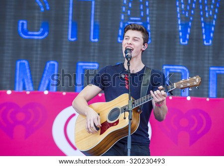 LAS VEGAS - SEP 19 : Singer Shawn Mendes performs onstage at the 2015 iHeartRadio Music Festival at the Las Vegas Village on September 19, 2015 in Las Vegas, Nevada. - stock photo