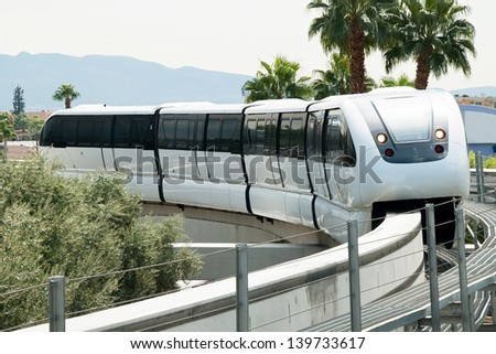 LAS VEGAS - SEPTEMBER 30:Monorail arriving to station on the Las Vegas Strip on September 30, 2011 in Las Vegas, USA. It connects the unincorporated communities of Paradise and Winchester. - stock photo