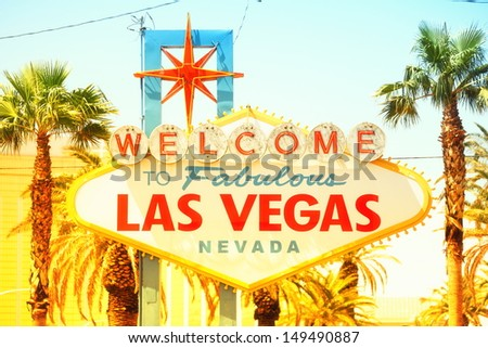 Las Vegas sign. Welcome to Fabulous Las Vegas sign, Nevada. Vintage retro style with warm glowing sun sunshine. - stock photo