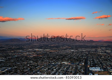 Las Vegas sunset aerial view with building street and mountains - stock photo