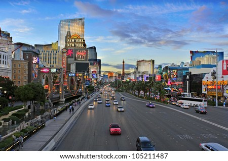 LAS VEGAS, US - OCTOBER 11: Las Vegas Strip at sunset on October 11, 2011 in Las Vegas, US. 19 of the 25 largest hotels of the world are on the Strip - stock photo