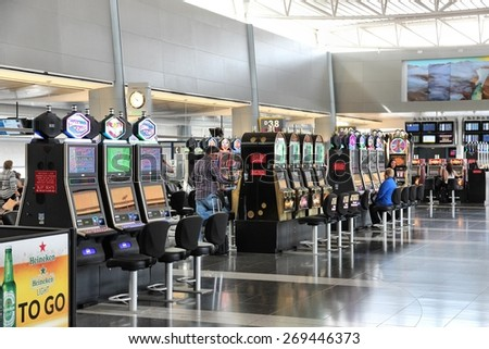 LAS VEGAS, USA - APRIL 15, 2014: Travelers wait at Las Vegas McCarran International Airportt in USA. It was the 24th busiest airport in the world with 41,856,787 passengers in 2013. - stock photo