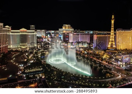 LAS VEGAS, USA - July 1, 2012: Fountain show at Bellagio hotel and casino on July 1, 2012 in Las Vegas, USA. Caesars Palace, The Flamingo and Bally's casino are in the back ground. - stock photo