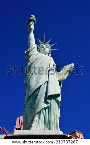 Las Vegas, USA - June 12, 2013: The statue is a replica of the original Statue of Liberty and stands outside the New York New York Hotel in Las Vegas, Nevada - stock photo