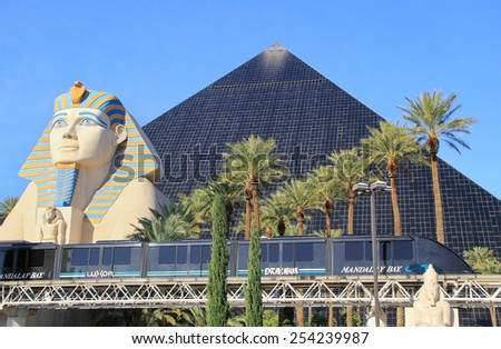 LAS VEGAS, USA - MARCH 19: Luxor hotel and casino and Mandalay Bay tram on March 19, 2013 in Las Vegas, USA. Las Vegas is one of the top tourist destinations in the world.  - stock photo