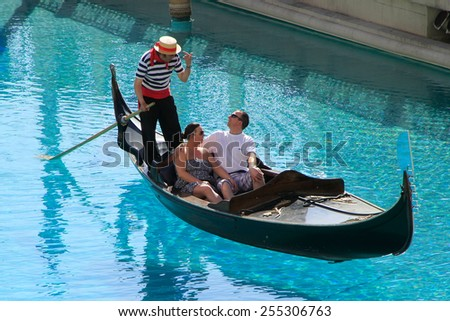 LAS VEGAS, USA - MARCH 19: Unidentified people take gondola ride at Venetian Resort hotel and casino on March 19, 2013 in Las Vegas, USA. Las Vegas is one of the top tourist destinations in the world. - stock photo