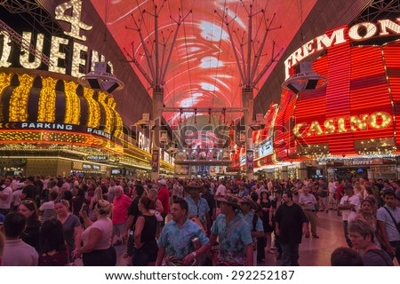 LAS VEGAS, USA - MAY 28, 2015: Huge crowds of tourists gather under the world's largest video screen to enjoy live entertainment, beer, food and casinos at the Fremont Street Experience in Las Vegas - stock photo