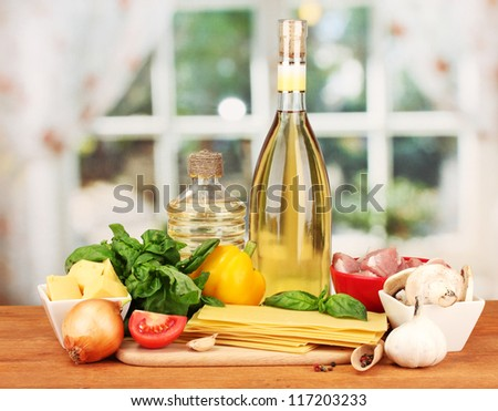 Lasagna ingredients on bright background - stock photo