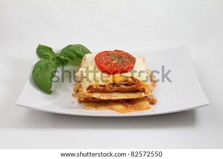 lasagna on white plate isolated on white background - stock photo
