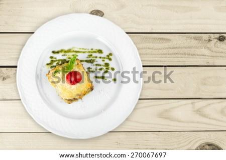 Lasagna, parmesan, closeup. - stock photo