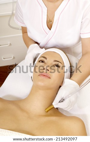 Laser hair removal in professional beauty studio. beauty parlor - stock photo