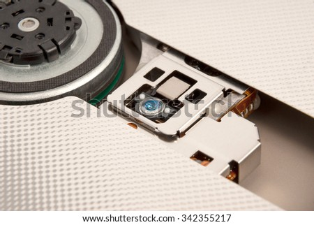 Laser head of CD DVD drive, macro shot - stock photo