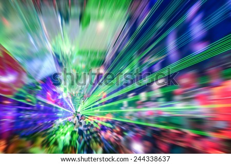 Laser show in modern disco party night club - Concept of nightlife with music and entertainment -  Image edited with radial zoom defocusing  - stock photo