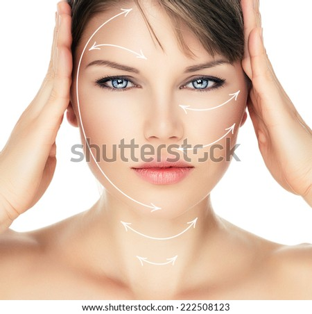Laser therapy on pretty woman face over white background. Young attractive Caucasian female ready for cosmetic operation. - stock photo