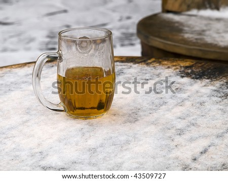 last beer glass in 2009 year on snow - stock photo