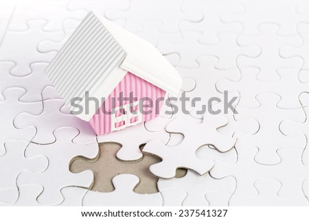 Last piece of jigsaw build your home concept - stock photo