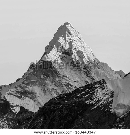 Last sun rays on the Ama Dablam (6814 m) at sunset (view from Kala Patthar (5600 m))- Everest region, Nepal, Himalayas (black and white) - stock photo