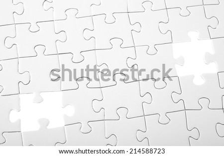 Last two pieces of white puzzle - stock photo