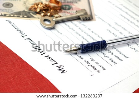 Last will and estate with pen, close-up - stock photo