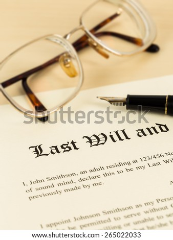 Last will on cream color paper with glasses and pen; document is mock-up - stock photo