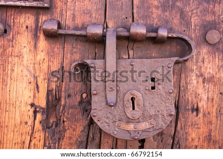 Latch or lock old in a spanish colonial house. Downtown. Candelaria district, Bogota, Colombia. - stock photo
