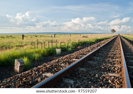 Late afternoon landscape with railway line - stock photo