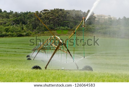 Late afternoon photo of a complete 2 section center pivot irrigation system with mountainsin the background - stock photo