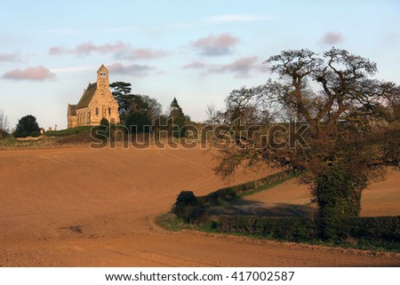 Late afternoon sun on an English Parish Church near the village of Leavening in the countryside of North Yorkshire in northeast England. - stock photo