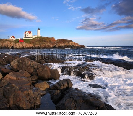 Late Afternoon Sunshine Bathes The Nubble Light, A Pastoral New England Seascape And A Truly Classic Lighthouse, Cape Neddick, Maine, USA - stock photo