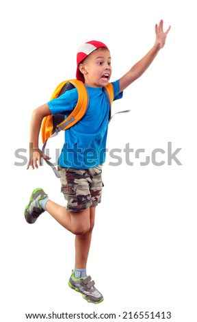 Late for school. Portrait of a little schoolchild with backpack and a cap running, waving with his hand and shouting. Isolated over white background - stock photo