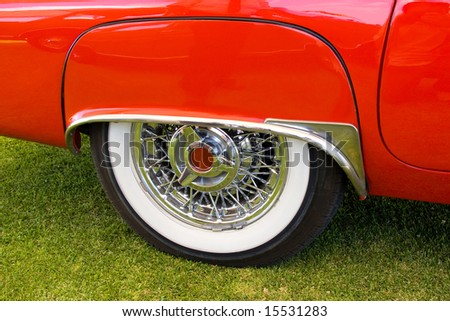lateral red american vintage car, white wheel - stock photo