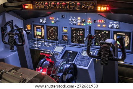 Lateral view of cockpit in homemade flight simulator - Concept of aerospace industry development - Flying simulation school for aviation learning pilots - All lights on ready for takeoff experience - stock photo
